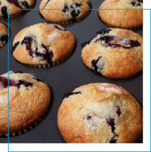 Fresh out of the oven blueberry muffins in a baking tin