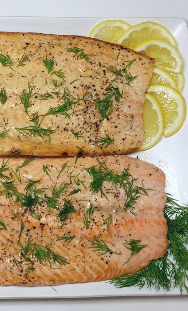 Two Dijon Maple Glazed Filets of Salmon on a white plate