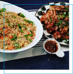 Fried rice and a plate of chicken satay with peanut sauce